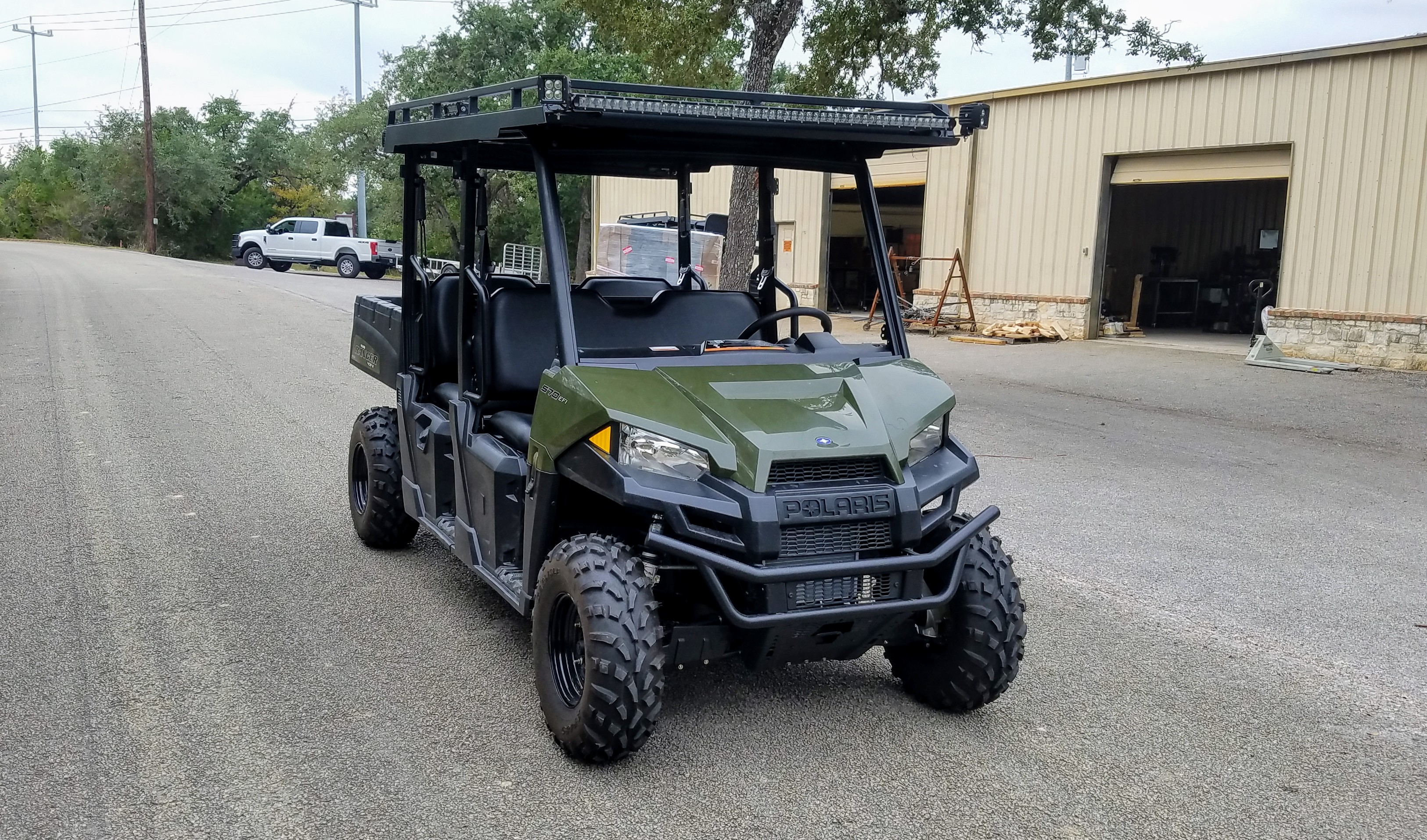 polaris-mid-size-crew-metal-roof-with-led-light-bars-and-utility-rack-570.jpg
